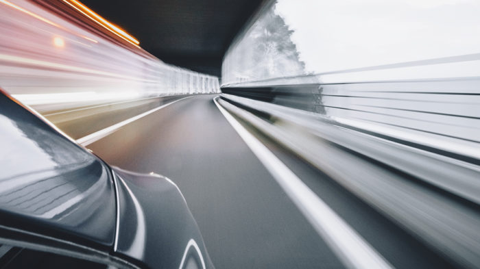 Car in a tunnel, blurred by speed