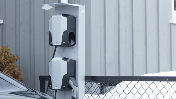Two charging stations mounted on a pole