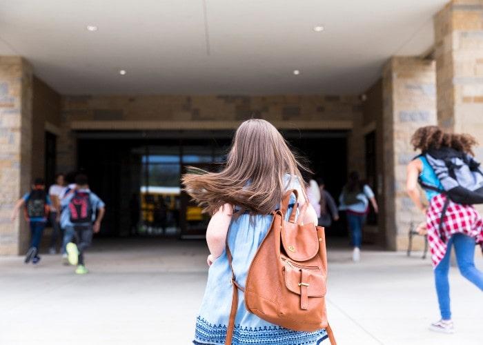 Girl outside school entrance