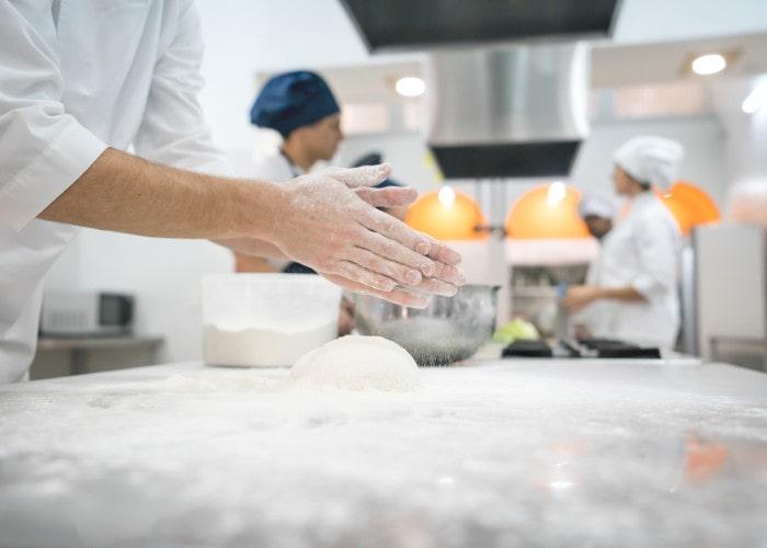 Chefs hands in school kitchen