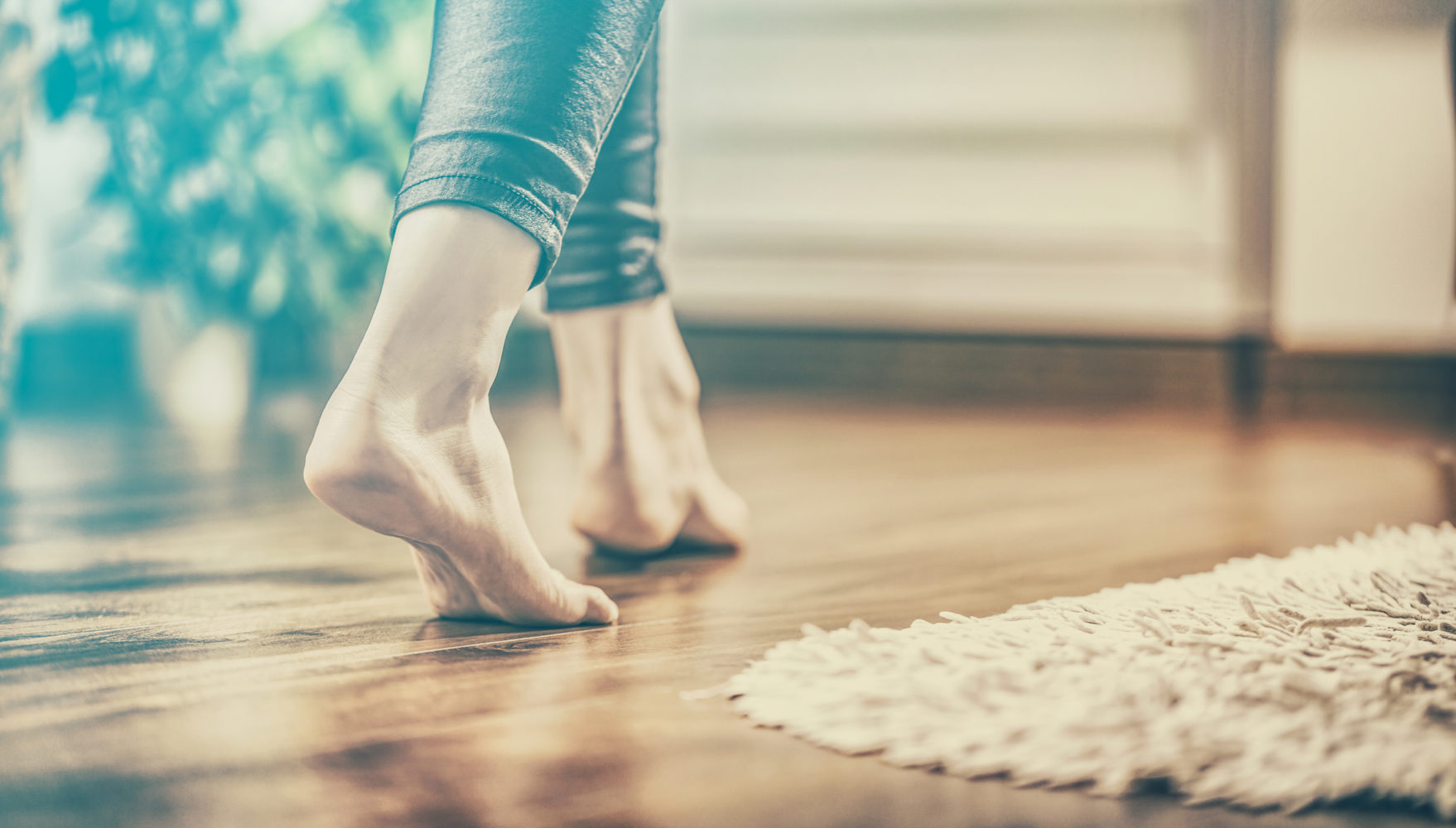 Bare feet on a parquet floor. Control floor heating with DEFA Cabin Control